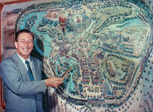 Walt Disney with an early map of disney land